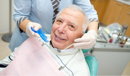 Older man smiling during treatment