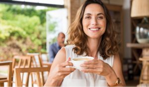 Woman smiling enjoying coffee